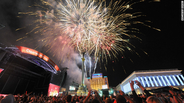 Fireworks are let off in the fanzone in Kiev after the Euro 2012 final between Italy and Spain on July 1, 2012.