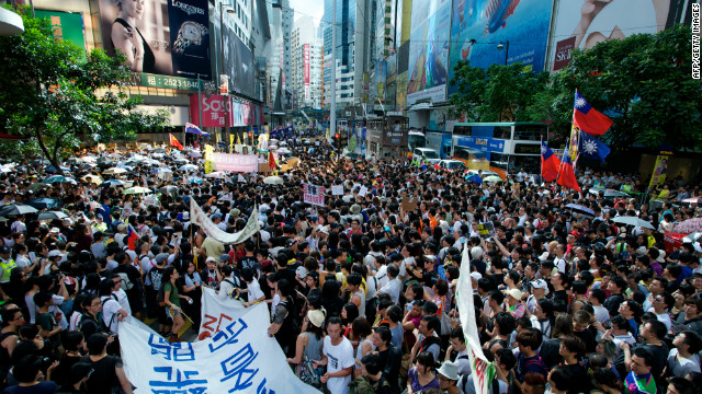Thousands of protesters take to the streets calling for universal suffrage and chanting slogans against new Hong Kong Chief Executive Leung Chun-ying in Hong Kong on July 1, 2012 only hours after Chinese President Hu Jintao completed his three-day visit to the southern Chinese territory. Hong Kong's new leader Leung Chun-ying, who earlier in the day was sworn in at an inauguration ceremony, took over the city of seven million people amid falling popularity ratings, a series of setbacks and protests over his leadership before he even started his term. AFP PHOTO / Alex OGLE (Photo credit should read Alex Ogle/AFP/GettyImages)