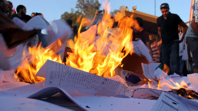 Pro-federalism Libyan protestors burn election materials outside the Headquarters of the Electoral Commission in the eastern coastal city of Benghazi on July 1, 2012 after ransacking the building to demand more seats for the city in the scheduled upcoming elections on July 5.