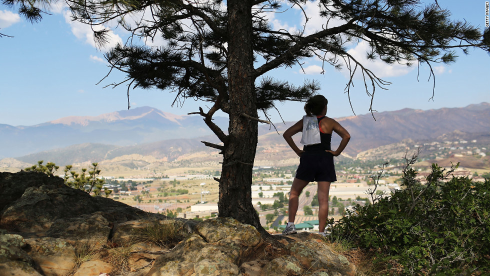 A jogger on Sunday looks out over neighborhoods in Colorado Springs that were evacuated due to the Waldo Canyon Fire. The massive fire has destroyed hundreds of homes and forced more than 32,000 people to flee.