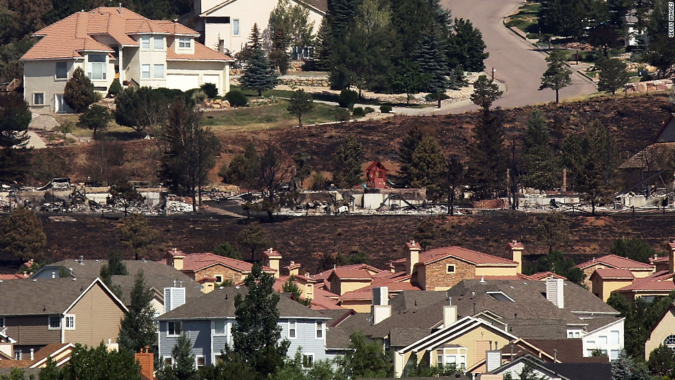Fire-destroyed homes are seen in the Mountain Shadows neighborhood in Colorado Springs, where hundreds of residents were given an eight-hour window to visit their properties on Sunday, July 1.