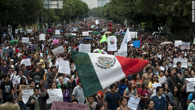 Thousands of protesters take to the streets in Mexico City on Monday, July 2,  day after the presidential election results were announced. The student movement is protesting against Enrique Peña Nieto, who declared victory late Sunday.
