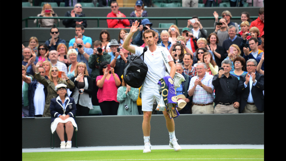 Britain's Andy Murray waves to the crowd after his fourth round men's singles victory over Croatia's Marin Cilic on Day Eight of the 2012 Wimbledon Championships tennis tournament.