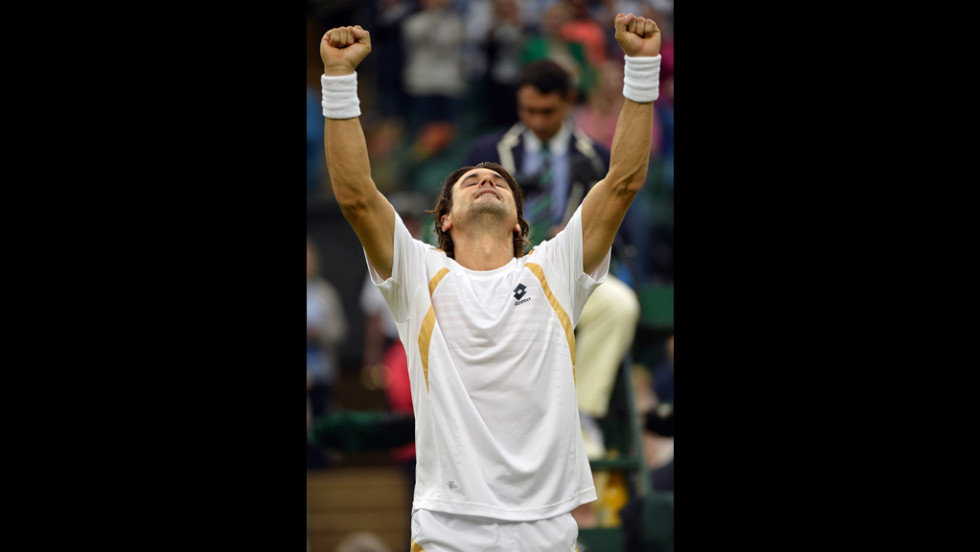 Spain's David Ferrer celebrates after his fourth round men's singles victory over Argentina's Juan Martin Del Potro on Day Eight of Wimbledon.