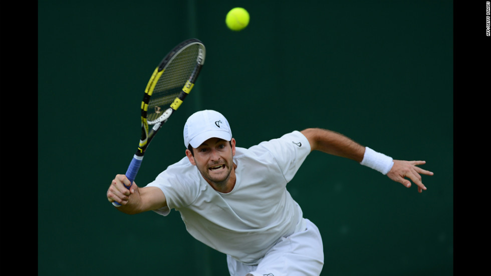 U.S. player Brian Baker plays a forehand shot during his fourth round men's singles defeat to Germany's Philipp Kohlschreiber on Day Eight of Wimbledon.