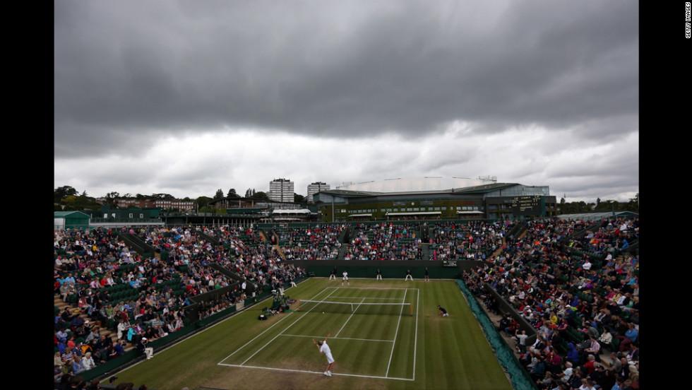 Tsonga of France plays American Mardy Fish on Day Eight of Wimbledon.