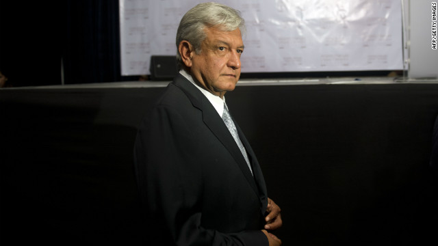 The presidential candidate for the leftist coalition Progressive Movement of Mexico, Andres Manuel Lopez Obrador, arrives at a press conference in Mexico City, a day after the presidential elections, on July 2, 2012 in Mexico City. Lopez Obrador, the winner's nearest rival, refused to concede the race to Enrique Pena Nieto of the Institutional Revolutionary Party until the official final results be released, claiming to have data showing different results. AFP PHOTO/Yuri CORTEZ (Photo credit should read YURI CORTEZ/AFP/GettyImages)