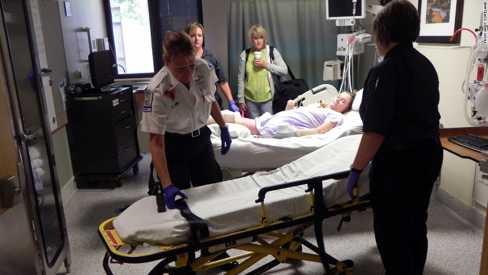 """Medical workers prepare Copeland for release from the hospital as her mother, Donna Copeland, waits alongside. """"She's been seeing those four walls inside that hospital for a long time,"""" said Andy Copeland, her father."""