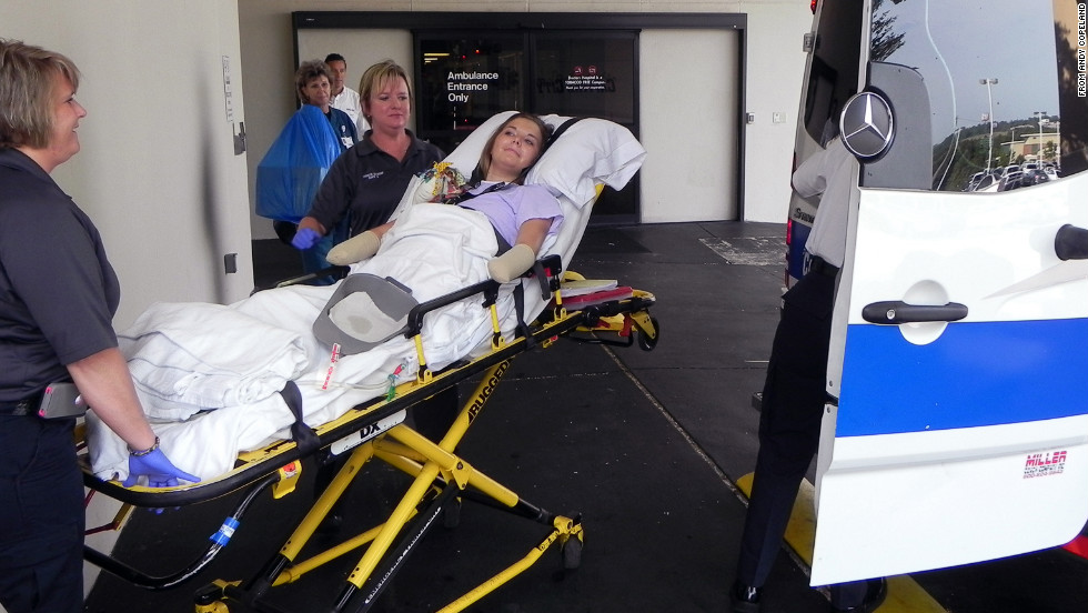 After two months in the hospital, Aimee Copeland is transferred into an ambulance outside Doctors Hospital in Augusta, Georgia, on Monday to continue her recovery from a flesh-eating bacteria at a rehab facility on July 2. She stayed in a rehab center before returning home.