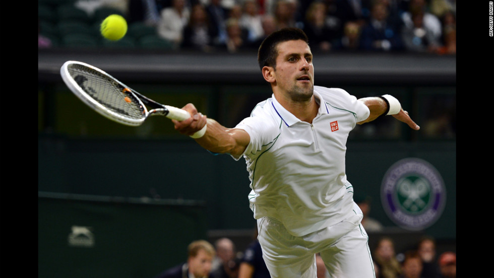 Serbia's Novak Djokovic plays a forehand shot during his fourth round men's singles victory over Serbia's Viktor Troicki on Day Seven of the Wimbledon championships on Monday, July 2.