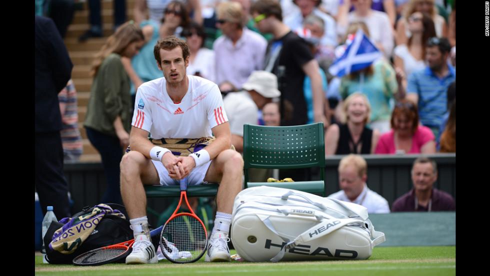 Murray ponders between games during his men's singles quarter-final match against Ferrer.