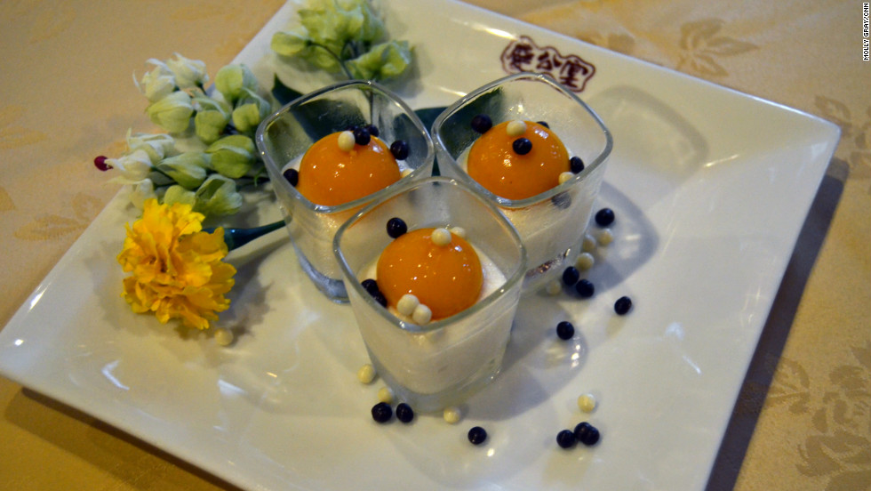 "Private kitchen Club Qing calls this dessert ""Egg"" after the source of protein is ressembles. It is made of tofu and mango."