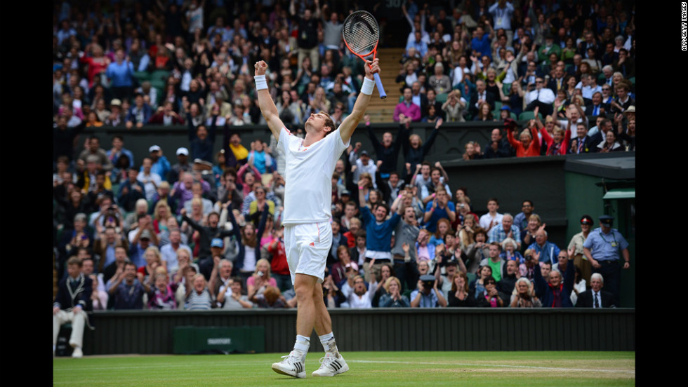 Britain's Andy Murray celebrates his men's singles quarter-final victory over Spain's David Ferrer on Day Nine of the Wimbledon Lawn Tennis Championships at the All England Lawn Tennis and Croquet Club on Wednesday in London, England.