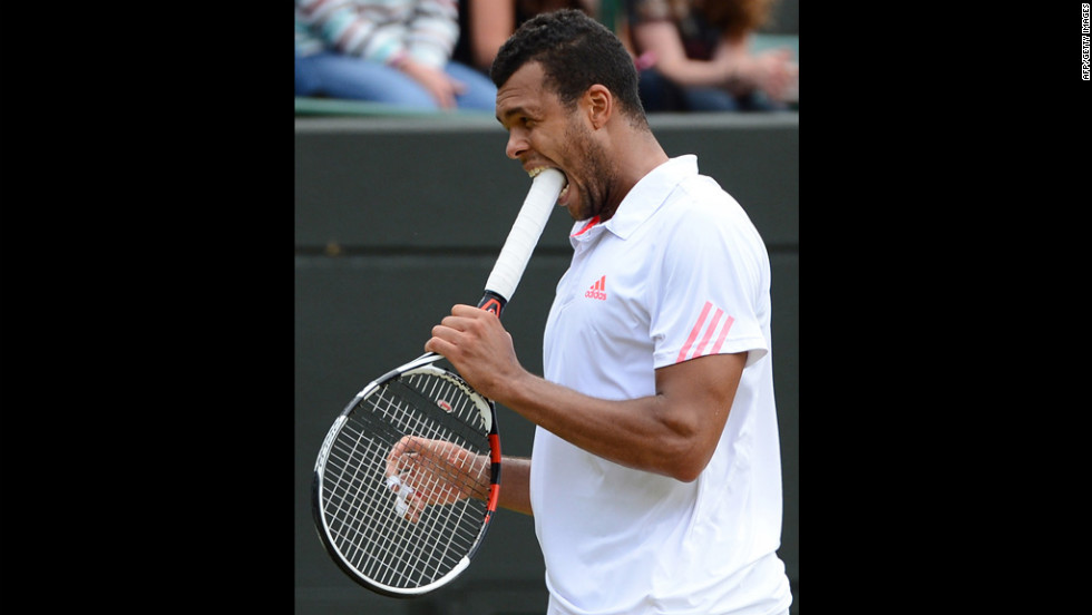 France's Jo-Wilfried Tsonga bites his racket during his men's singles quarter-final match against Germany's Philipp Kohlschreiber on Wednesday.