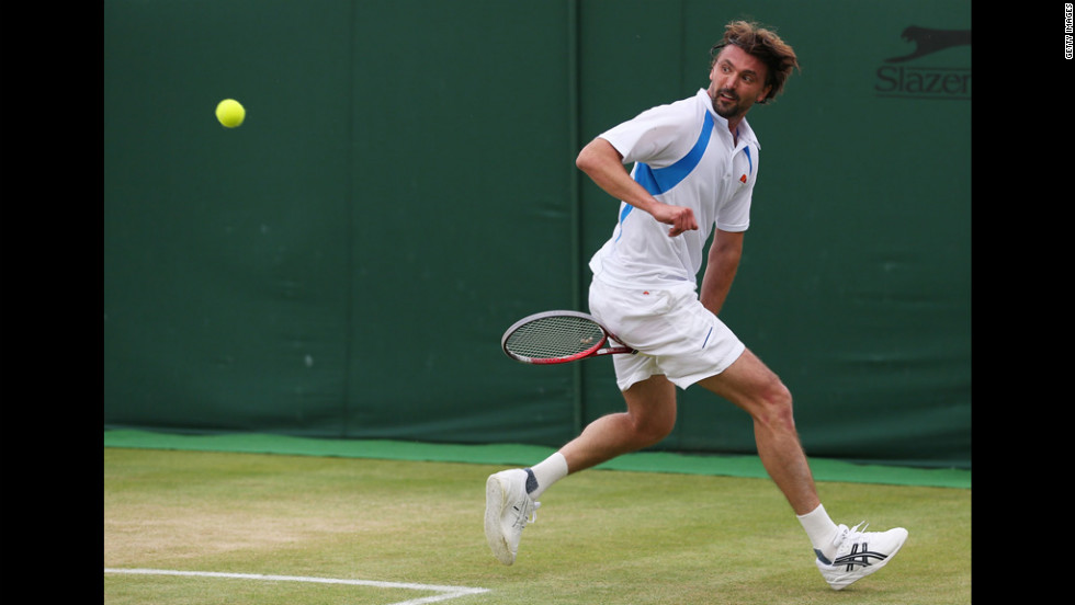 Goran Ivanisevic of Croatia and team-mate Cedric Pioline of France play against Jacco Eltingh and Paul Haarhuis of the Netherlands on Wednesday.