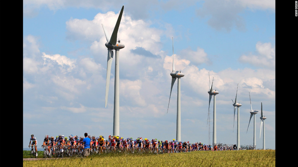 The peloton passes by windmills on Wednesday.