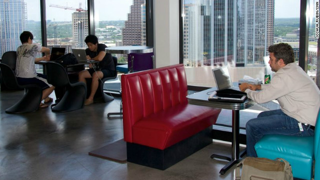 With the city's skyline in the background, tech entrepreneurs work at Austin's Capital Factory.