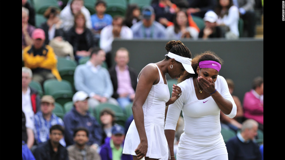 American Venus Williams confers with sister Serena, right, during their third round women's doubles match against American Bethanie Mattek-Sands and India's Sania Mirza on Wednesday.