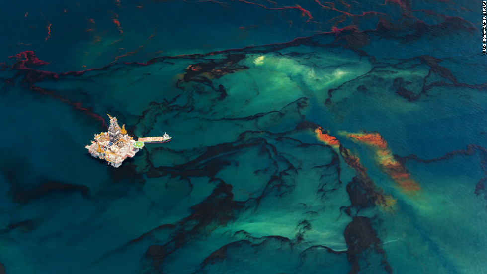 "The series ""Spill"" by Spanish photographer Daniel Beltrá documents the world's largest marine oil spill following the 2010 explosion of BP's <a href=""http://www.cnn.com/2012/04/20/opinion/brazile-earth-day-bp/index.html"">Deepwater Horizon</a> rig in the Gulf of Mexico."