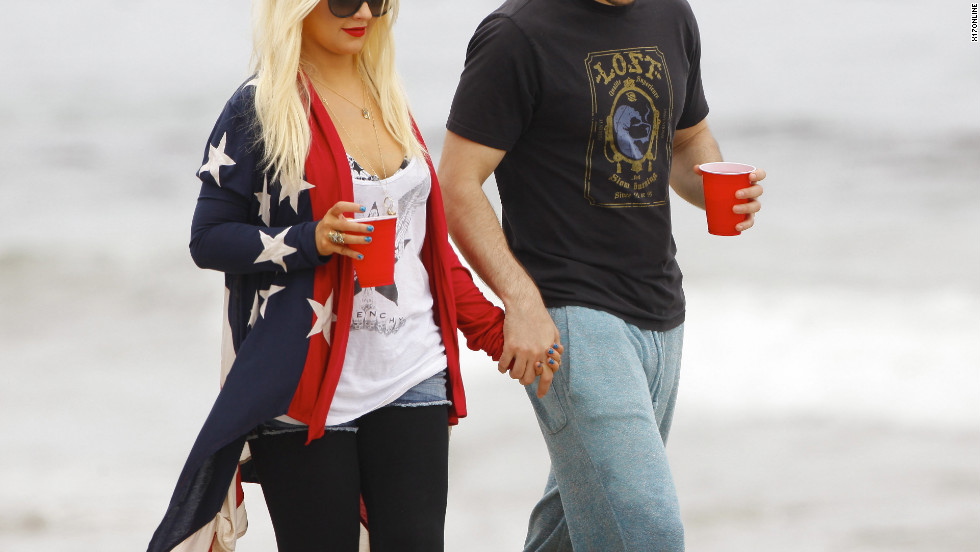 Christina Aguilera and her boyfriend go to a beach in Malibu.
