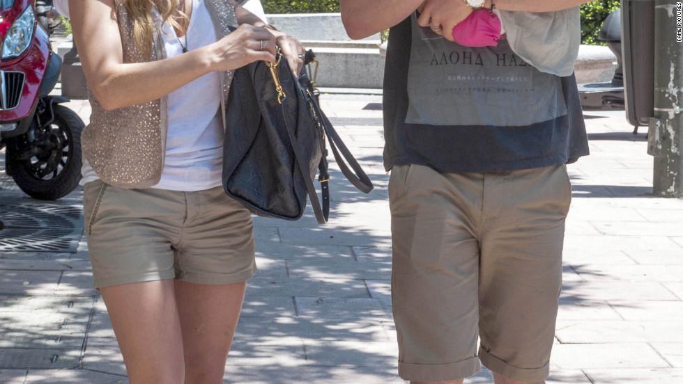 Elsa Pataky and Chris Hemsworth roam around Madrid with their baby.
