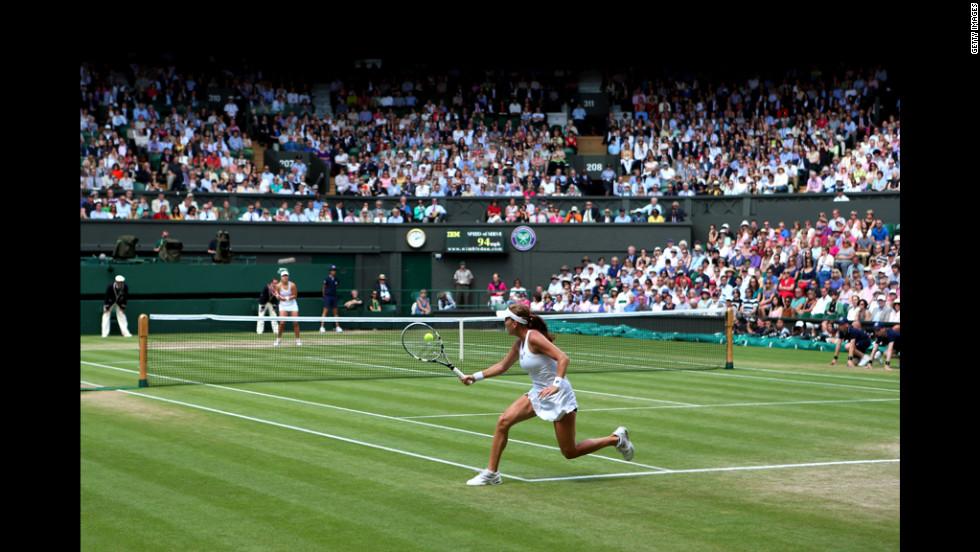 Radwanska returns a shot during her Ladies' Singles semifinal match against Kerber.