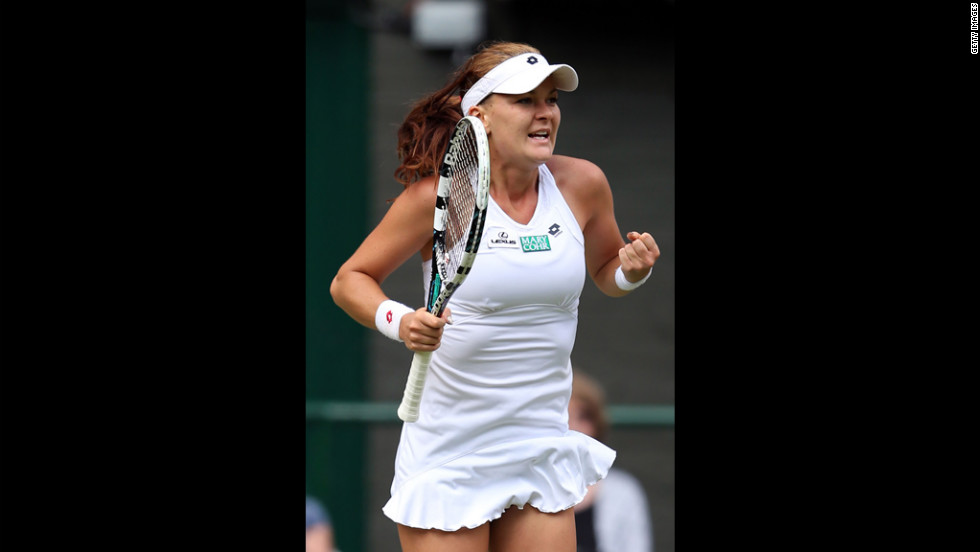 Radwanska celebrates match point during her Ladies' Singles semifinal match against Kerber.