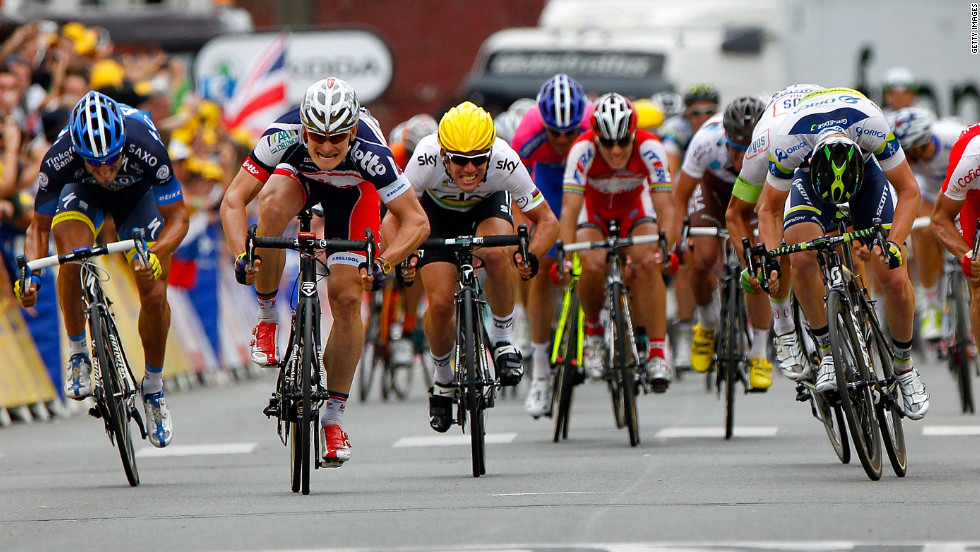 Andre Greipel, second from left, of the Lotto-Belisol team charges ahead to the finish line on Thursday to win Stage 5 of the Tour de France.