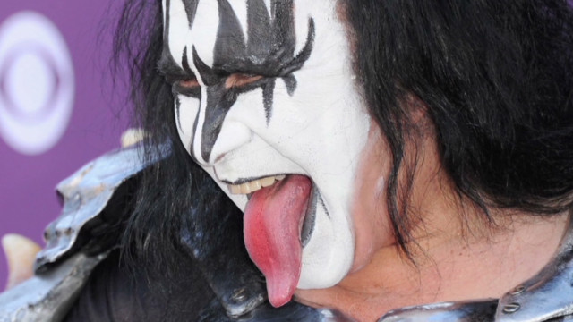 Gene Simmons poses with tongue