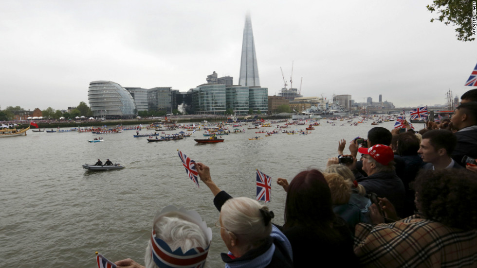 Crowds cheer as the flotilla passes the Shard during the Thames Diamond Jubilee Pageant on the River Thames in London on June 3, 2012.