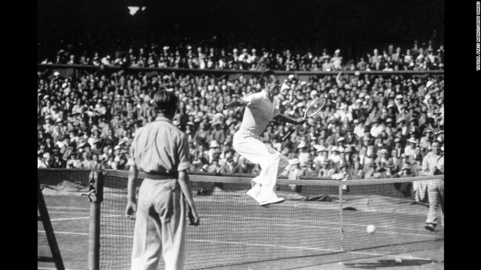 Perry jumps the net on July 1, 1936, after beating Donald Budge of the United States to win the men's singles semifinal.