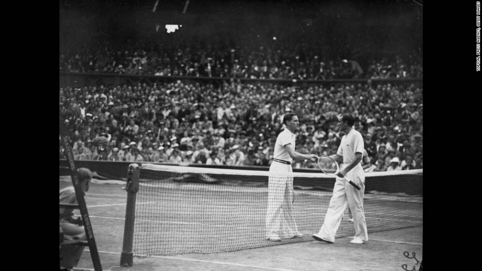Von Cramm shakes hands with Perry after Perry's victory in the men's singles final on the center court at the Wimbledon on July 3, 1936. Perry defeated the German player in straight sets.
