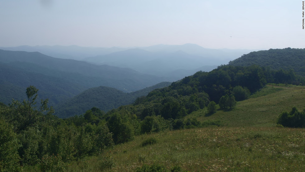 Many of the most famous parks in the world are among the U.S. National Park Service's 59 headliner national parks. Great Smoky Mountains National Park, which was the third most-popular park site in 2013 and 2014, was also the most popular national park for both years. Shown here is the view from Purchase Knob.