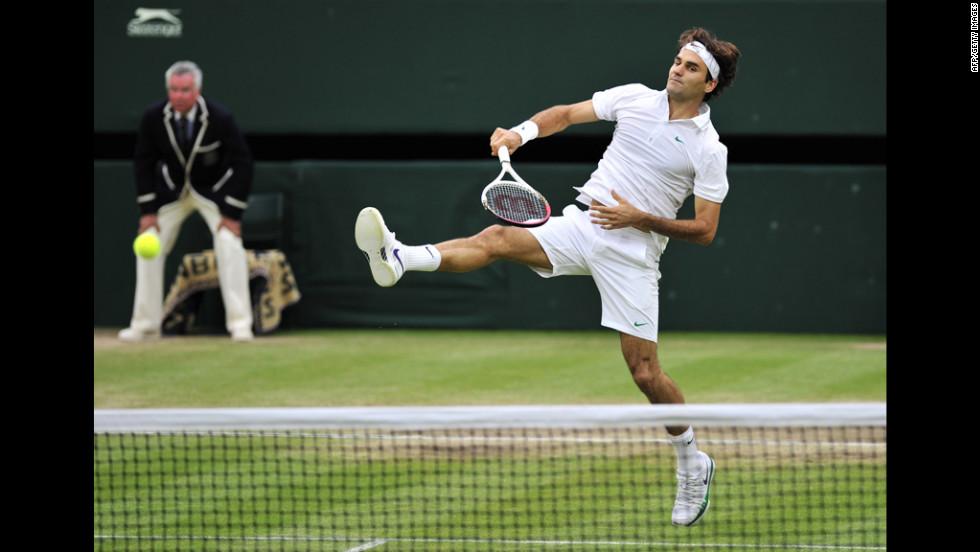Roger Federer plays a shot during his men's singles semifinal match against Novak Djokovic.