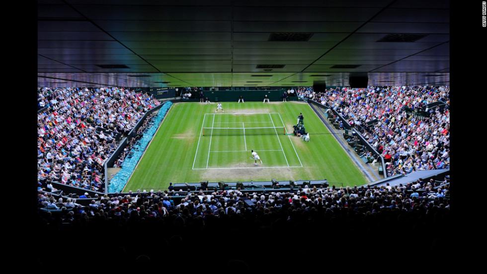Novak Djokovic serves the ball during his Gentlemen's Singles semifinal match against Roger Federer.