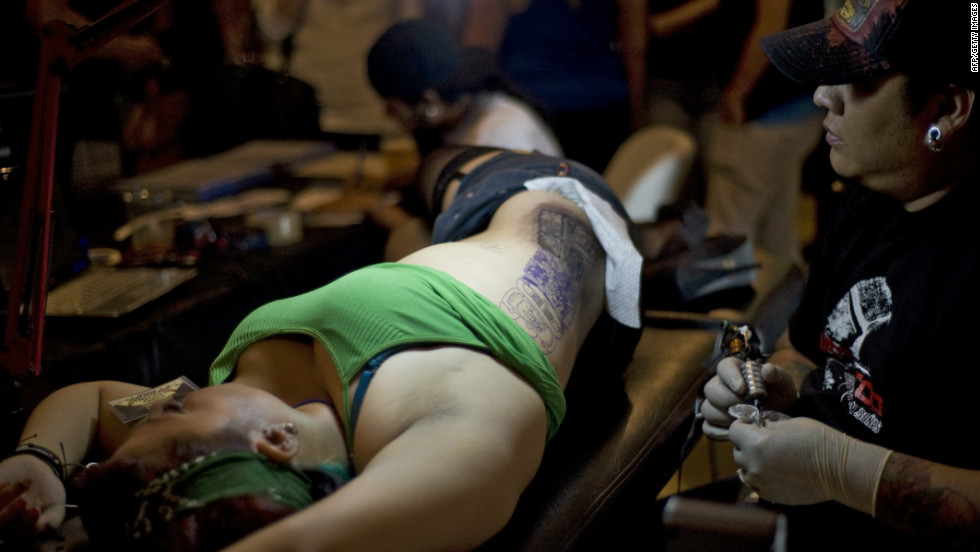 A tattoo artist works during the II Tattoo Expo in Guatemala City on June 16, 2012.