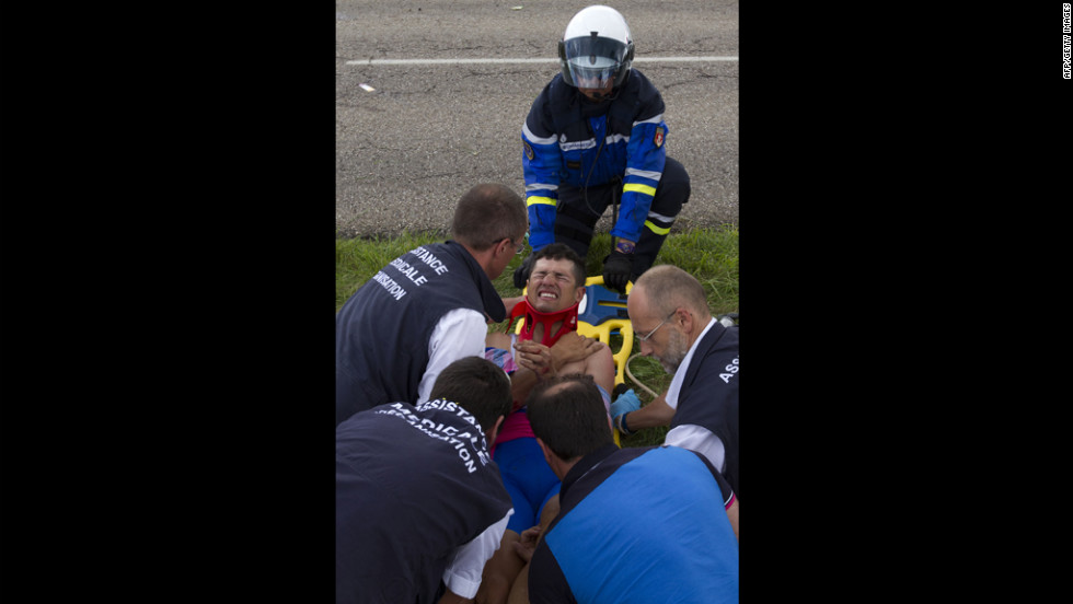 Italy's Davide Vigano is lifted on a stretcher after the crash on Friday, July 6.