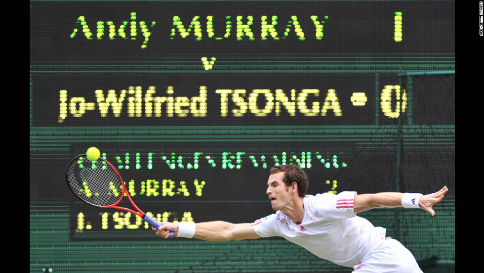 Murray stretches to make a forehand return against Tsonga.