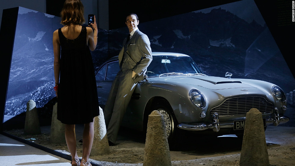 A Sean Connery waxwork and the famous Aston Martin DB5 greets fans outside the exhibition.
