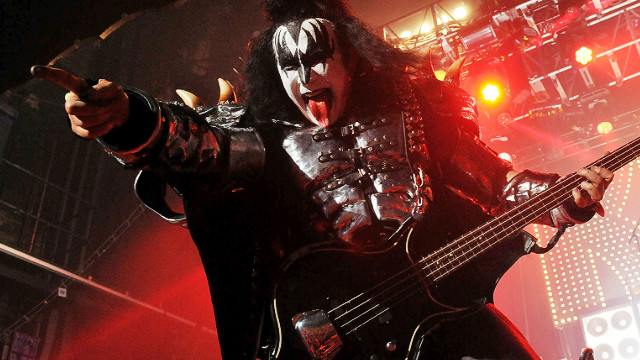 Gene Simmons points to camera while performing