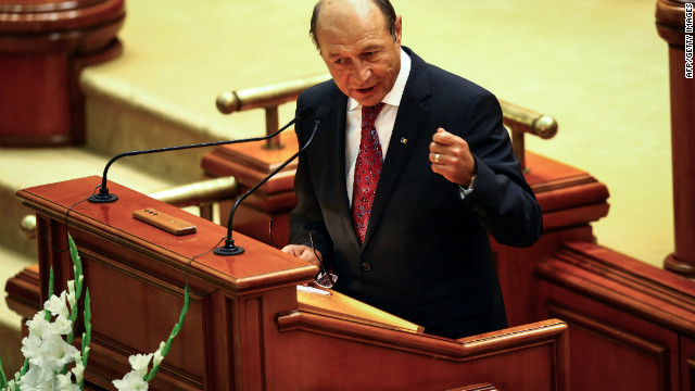 Romanian president Traian Basescu prepares to deliver a speech in front of the Romanian Parliament, on July 6, 2012.