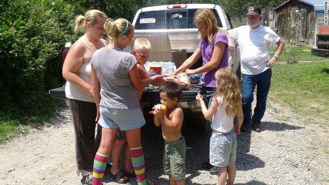 Volunteers hand out food and water to those without power in Kingston, West Virginia.