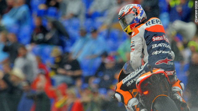 Casey Stoner looks back after setting the fastest lap in qualifying for the German MotoGP.