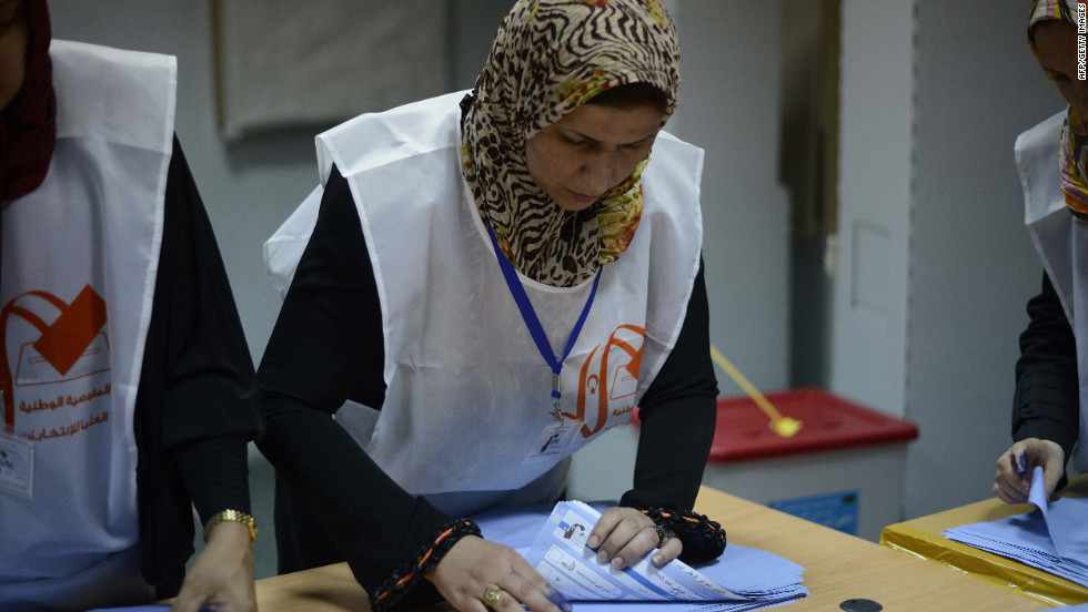 Libyan election workers start the ballot-counting process at a Tripoli polling station during Libya's General National Assembly.