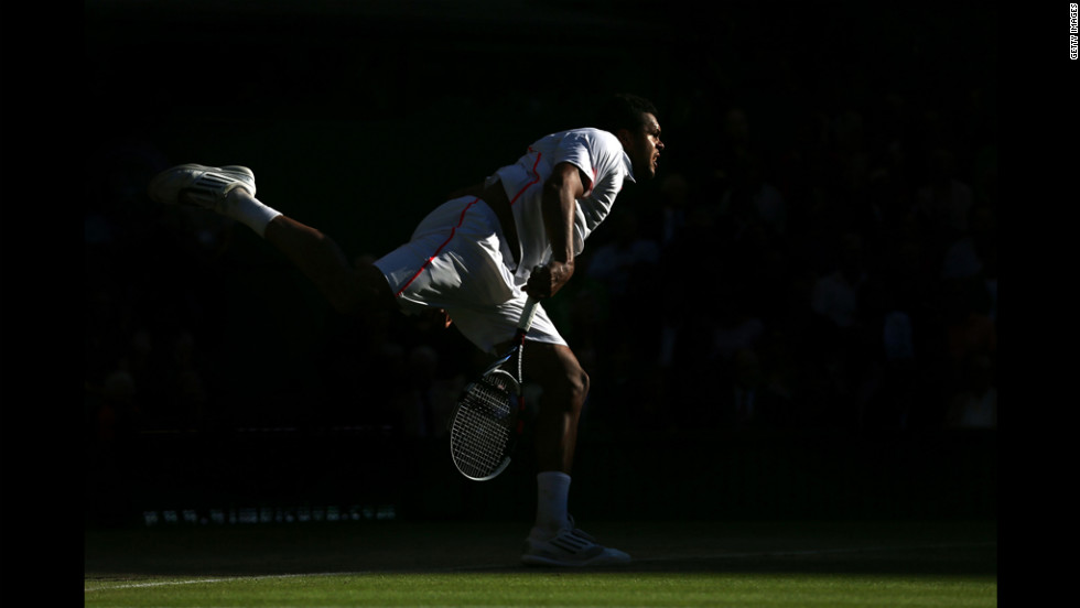 France's Jo-Wilfried Tsonga serves the ball during his Gentlemen's Singles semifinal match against Andy Murray of Great Britain.