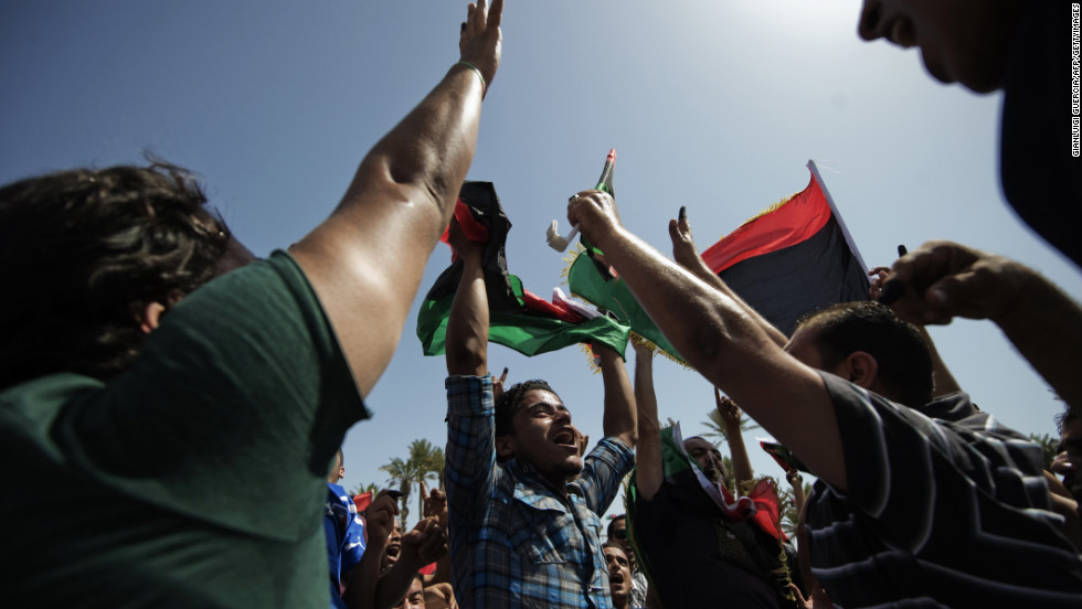 Libyans celebrate in Tripoli's Martyrs' Square after voting for the Libyan General National Assembly.