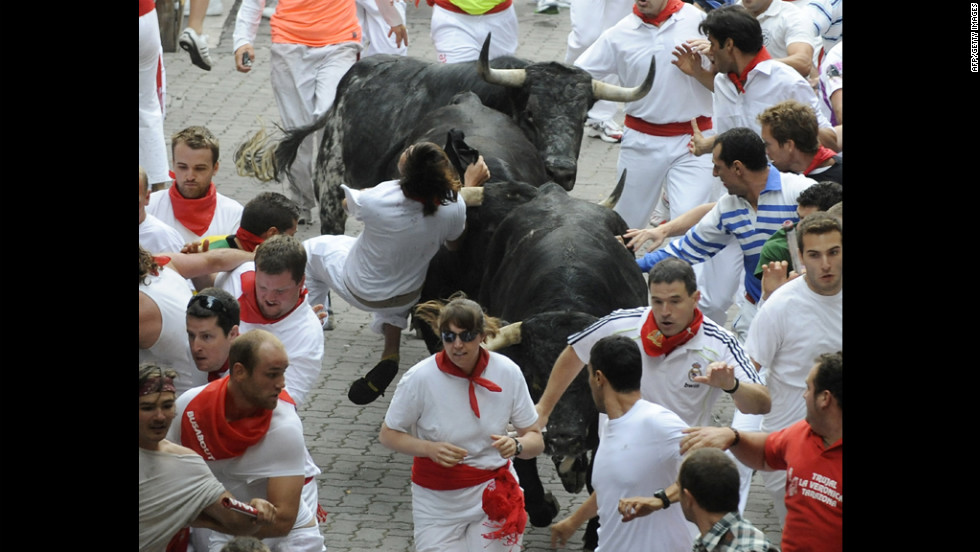 People try to escape the horns and hooves of the bulls on Saturday.