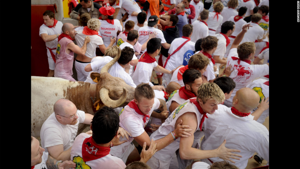 Runners push past each other to escape the bulls.