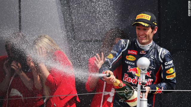 Red Bull's Australian driver Mark Webber celebrates after winning the British Grand Prix at Silverstone