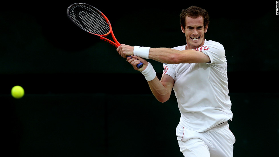 Murray, the first Briton to reach a men's singles final at Wimbledon in 74 years, returns a shot to Federer during the match Sunday.